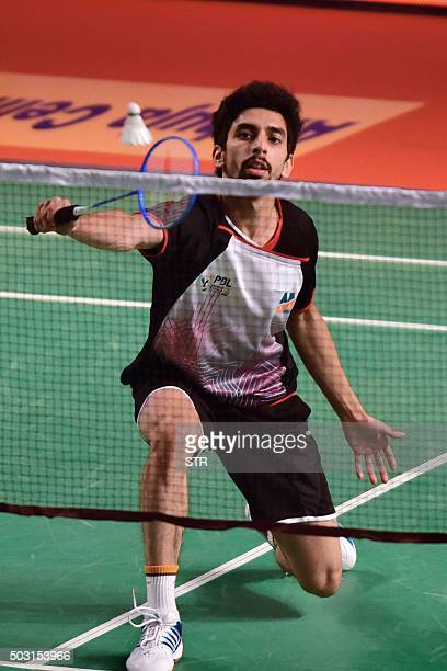 Mumbai Rockets player Gurusai Dutt returns to Sai Praneeth of Awadhe Warriors during their Premier Badminton League match in Mumbai on January 2 2016...