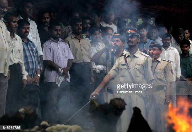 It was a day of mass funerals at the Oshiwara and Borivli crematorium on Wednesay in the picture above policemen pay last repsects to the funeral...