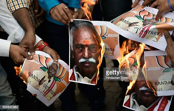 Mumbai Youth Congress members burn the photograph of Union Minister of Labour and Employment Bandaru Dattatreya while protesting over the death of...