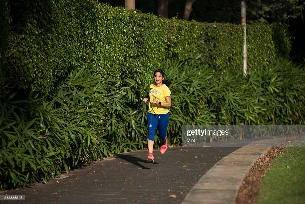 Mumbai-based designer and avid marathoner Manika Jain is practicing for her 42 km marathon run on December 12, 2015 in Mumbai, India.