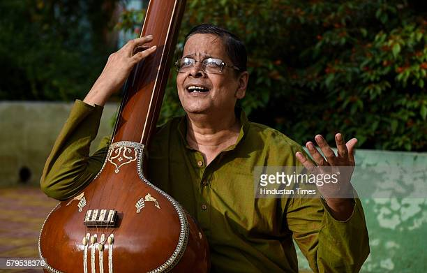 Mumbaibased Hindustani classical music teacher Kiran Pathak with his instrument poses during an exclusive interview with ht48hoursHindustan Times at...