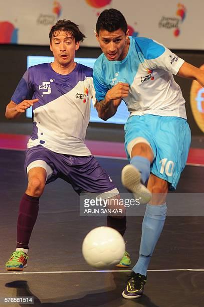 Mumbai's Angellot plays against Kochi 5's Changuinha during their Premier Futsal Football League match in Chennai on July 16 2016 / AFP / ARUN SANKAR