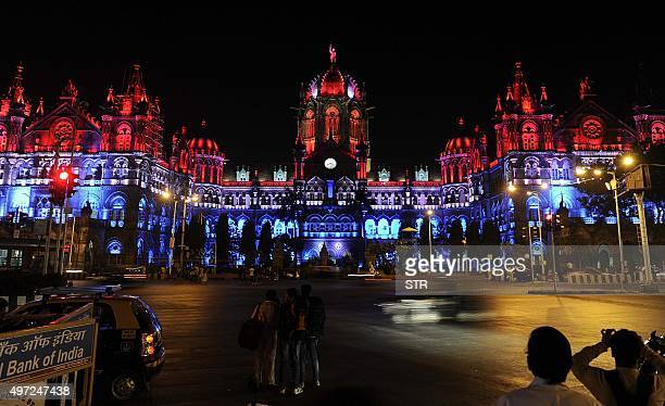 Mumbai's main railway station the Chhatrapati Shivaji Terminus is lit up in the colours of the French national flag on November 15 2015 to express...