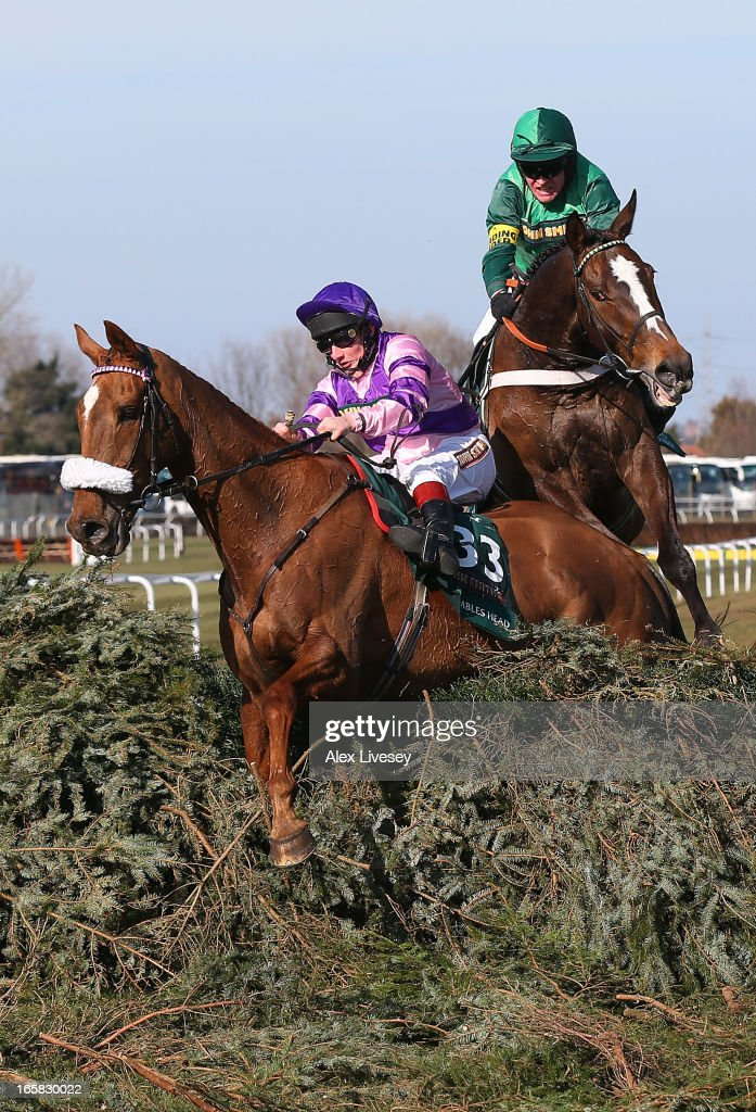 Mumbles Head ridden by Jamie Moore (L) and Roberto Goldback ridden by Barry Geraghty refuse the last fence during the John Smiths Grand National Steeple Chase at Aintree Racecourse on April 6, 2013 in Liverpool, England.