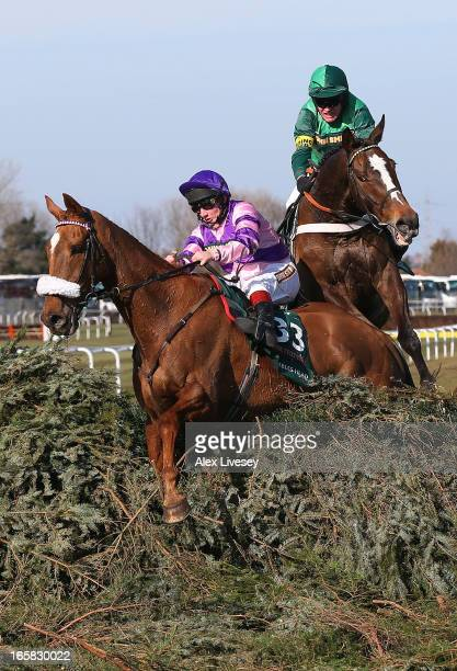 Mumbles Head ridden by Jamie Moore and Roberto Goldback ridden by Barry Geraghty refuse the last fence during the John Smiths Grand National Steeple...