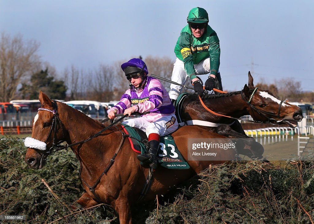 Mumbles Head ridden by Jamie Moore (L) and Roberto Goldback ridden by Barry Geraghty refuse the last fence during the John Smiths Grand National at Aintree Racecourse on April 6, 2013 in Liverpool, England.