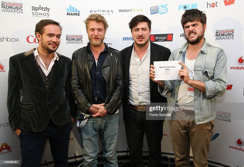 <a gi-track='captionPersonalityLinkClicked' href=/galleries/search?phrase=Mumford+and+Sons&family=editorial&specificpeople=6826176 ng-click='$event.stopPropagation()'>Mumford and Sons</a> (L-R) <a gi-track='captionPersonalityLinkClicked' href=/galleries/search?phrase=Ben+Lovett&family=editorial&specificpeople=3039181 ng-click='$event.stopPropagation()'>Ben Lovett</a>, <a gi-track='captionPersonalityLinkClicked' href=/galleries/search?phrase=Ted+Dwane&family=editorial&specificpeople=5856816 ng-click='$event.stopPropagation()'>Ted Dwane</a>, <a gi-track='captionPersonalityLinkClicked' href=/galleries/search?phrase=Marcus+Mumford&family=editorial&specificpeople=5385533 ng-click='$event.stopPropagation()'>Marcus Mumford</a> and Country Winston-Marshall pose after presenting awards during the 2012 Vodafone New Zealand Music Awards at Vector Arena on November 1, 2012 in Auckland, New Zealand.