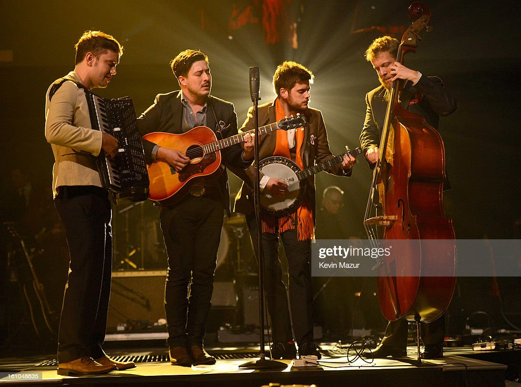 <a gi-track='captionPersonalityLinkClicked' href=/galleries/search?phrase=Mumford+and+Sons&family=editorial&specificpeople=6826176 ng-click='$event.stopPropagation()'>Mumford and Sons</a> perform onstage at MusiCares Person Of The Year Honoring Bruce Springsteen at Los Angeles Convention Center on February 8, 2013 in Los Angeles, California.
