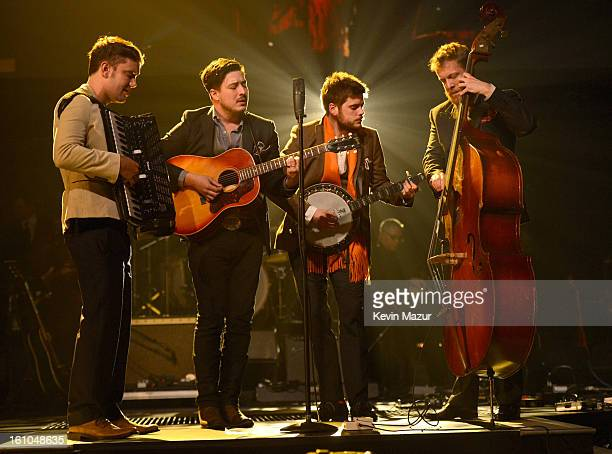 Mumford and Sons perform onstage at MusiCares Person Of The Year Honoring Bruce Springsteen at Los Angeles Convention Center on February 8 2013 in...