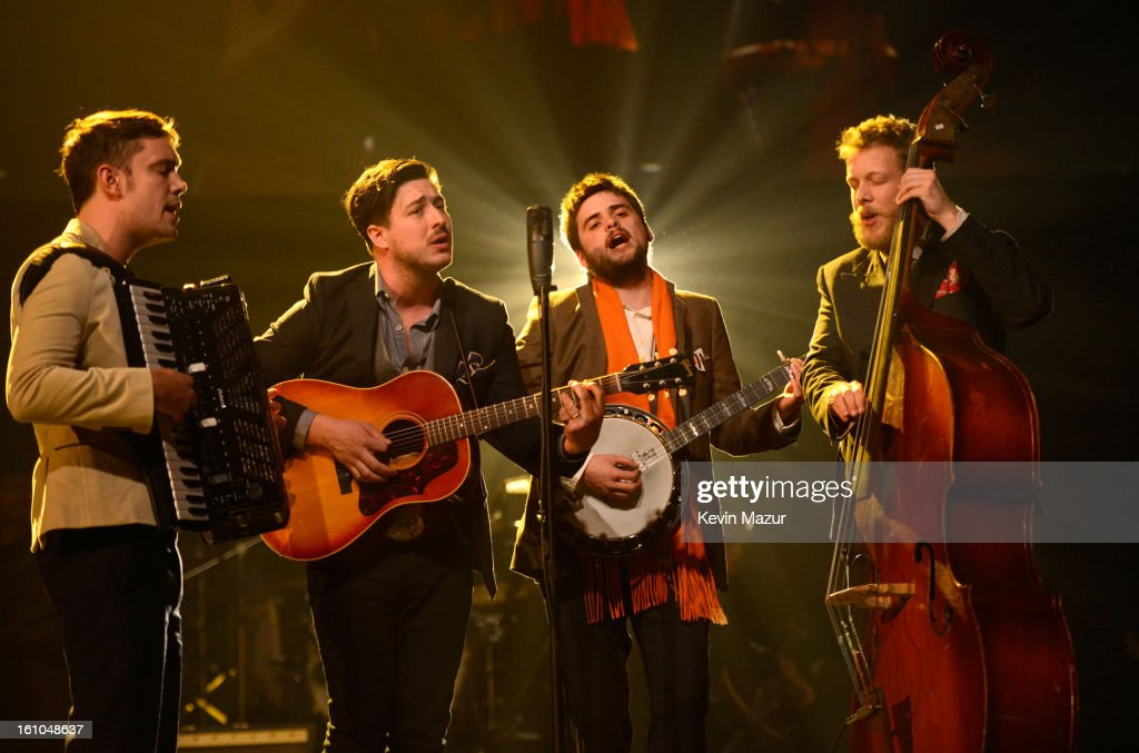 <a gi-track='captionPersonalityLinkClicked' href=/galleries/search?phrase=Mumford+and+Sons&family=editorial&specificpeople=6826176 ng-click='$event.stopPropagation()'>Mumford and Sons</a> perform onstage at MusiCares Person Of The Year Honoring <a gi-track='captionPersonalityLinkClicked' href=/galleries/search?phrase=Bruce+Springsteen&family=editorial&specificpeople=123832 ng-click='$event.stopPropagation()'>Bruce Springsteen</a> at Los Angeles Convention Center on February 8, 2013 in Los Angeles, California.