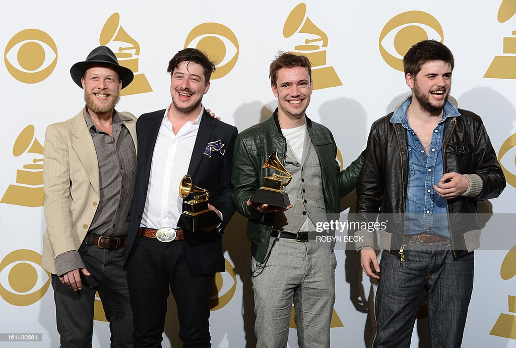 Mumford and Sons pose with their trophies in the press room at the Staples Center during the 55th Grammy Awards in Los Angeles, California, February 10, 2013. AFP PHOTO Robyn BECK