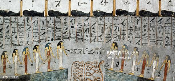 Mummies in black anthropoid sarcophagi twelve goddesses hours of the night snake in a pit fresco from the burial chamber of the Tomb of Ramesses I...