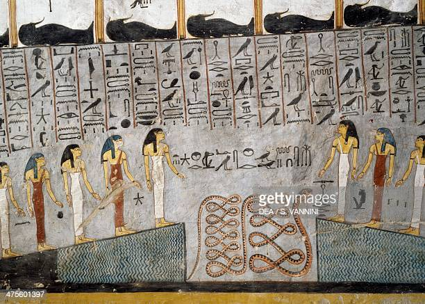 Mummies in black anthropoid sarcophagus goddesses and the figure of a snake in a pit fresco burial chamber Tomb of Ramesses I Valley of the Kings...