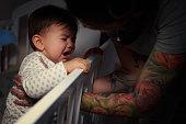 Mummy lulling baby to sleep