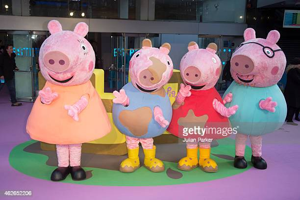 Mummy Pig George Peppa Pig and Daddy Pig characters attend the premeire of 'Peppa Pig The Golden Boots' at Odeon Leicester Square on February 1 2015...
