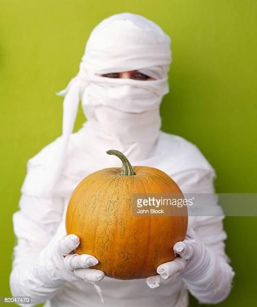 Mummy with pumpkin