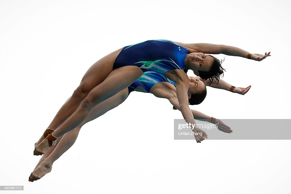 Mun Yee Leong and Jun Hoong Cheong of Malaysia compete in the Women's 10M Synchro Springboard Final during day three of the 19th FINA Diving World Cup at the Oriental Sports Center on July 17, 2014 in Shanghai, China.