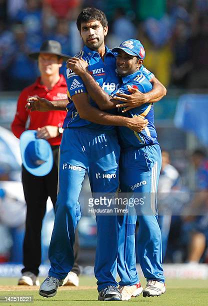 Munaf Patel and Ambati Rayud of the Mumbai Indians celebrate capturing the wicket of Wayne Parnell of the Pune Warriors during the IPL 5 match...