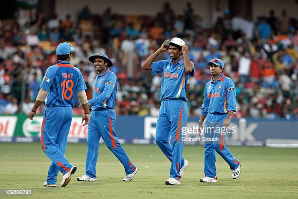 Munaf Patel and team mates of India leave the field after bowling Ireland out for 207 in the Group B 2011 ICC World Cup match between India and...