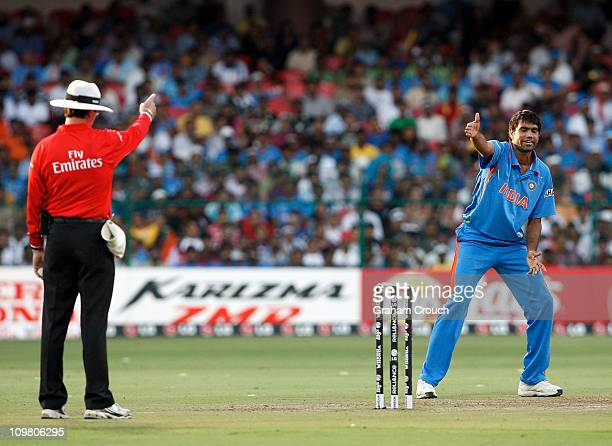 Munaf Patel of India appeals successfully for LBW against Trent Johnston of Ireland in the Group B 2011 ICC World Cup match between India and Ireland...