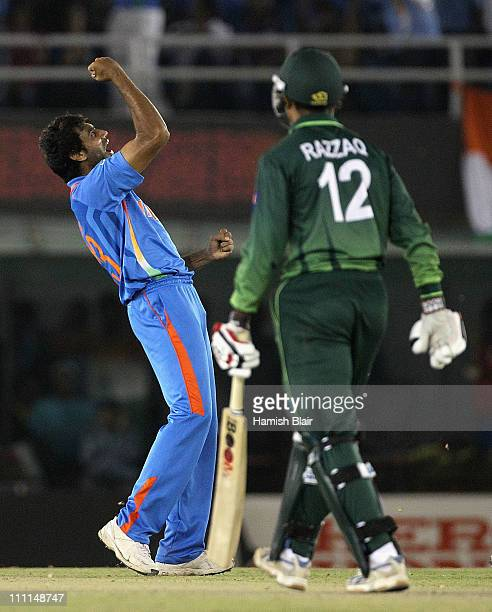 Munaf Patel of India celebrates after taking the wicket of Abdul Razzaq of Pakistan during the 2011 ICC World Cup second SemiFinal between Pakistan...