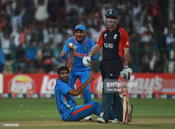 Munaf Patel of India celebrates taking the catch to dismiss Kevin Pietersen of England as Andrew Strauss of England looks on during the 2011 ICC...