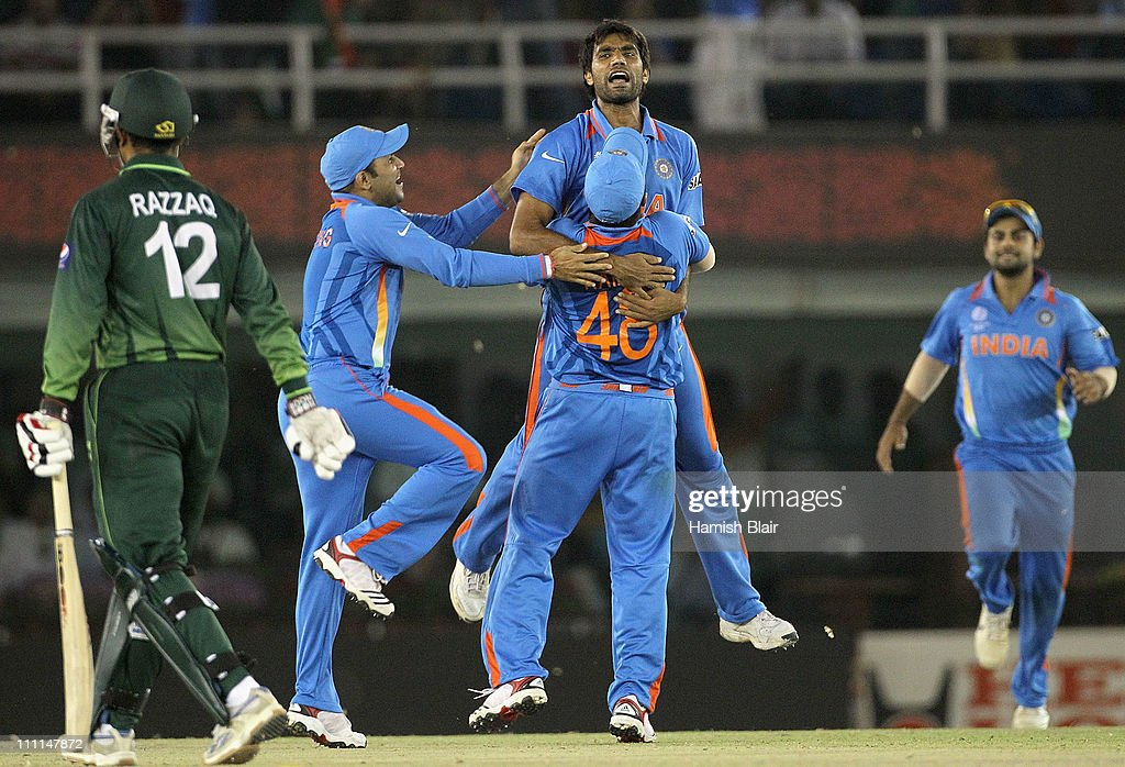 Munaf Patel of India celebrates with team mates after taking the wicket of Abdul Razzaq (L) of Pakistan during the 2011 ICC World Cup second Semi-Final between Pakistan and India at Punjab Cricket Association (PCA) Stadium on March 30, 2011 in Mohali, India.
