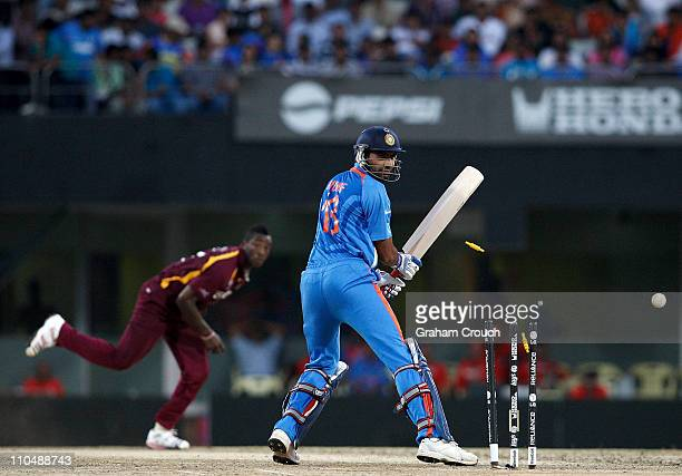 Munaf Patel of India is bowled by Andre Russell of West Indies during the Group B ICC World Cup match between India and West Indies at M A...