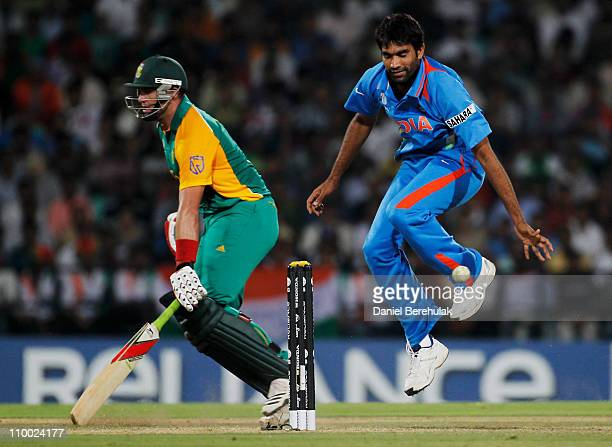 Munaf Patel of India is struck by a fielded ball as Jacques Kallis of South Africa makes it home safe during the Group B ICC World Cup Cricket match...