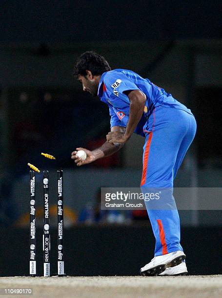 Munaf Patel of India runs out Darren Sammy of West Indies during the Group B ICC World Cup match between India and West Indies at M A Chidambaram...
