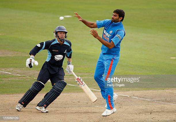 Munaf Patel of India stops a return shot watched by Chris Nash of Sussex during the one day tour match between Sussex and India at The County Ground...