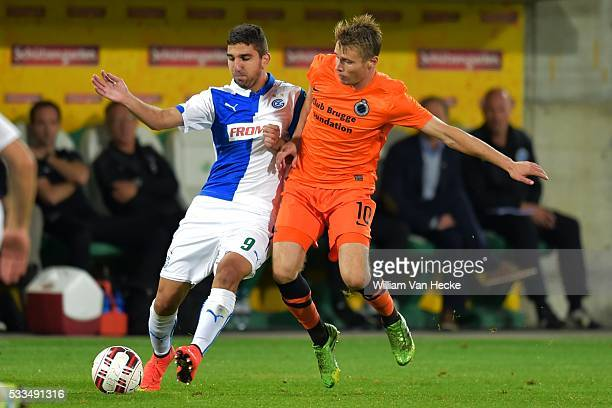 Munas Dabbur of Grasshopper Club battles for the ball with Jesper Jorgensen of Club Brugge during the Europa League play off game between...