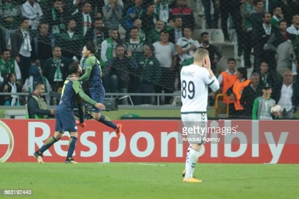 Munas Dabbur of Salzburg celebrates with his teammate Takumi Minamino after scoring during the UEFA Europa League Group I soccer match between Atiker...