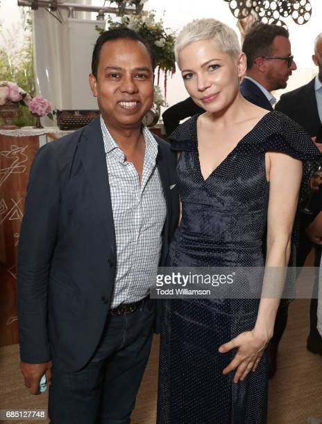 Munawar Hosain and Michelle Williams attends the 'Wonderstruck' Cannes After Party on May 18 2017 in Cannes