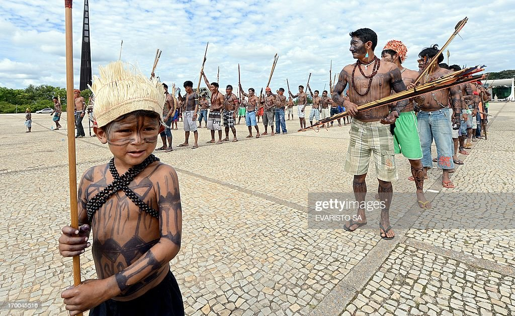 A Munduruku indigenous child takes part in a protest in front of the Planalto Palace in Brasilia, on June 6, 2013. Five indigenous tribes are calling for legislation under which they would have to be consulted prior to any official decision affecting them with respect to the dam's construction. Belo Monte, which is being built at a cost of $13 billion, is expected to flood an area of 500 square km along the Xingu River, displacing 16,000 people, according to the government. Some NGOs have estimated that some 40,000 people would be displaced by the massive project. Indigenous groups say the dam will harm their way of life while environmentalists warn of deforestation, greenhouse gas emissions and irreparable damage to the ecosystem. AFP PHOTO / Evaristo SA