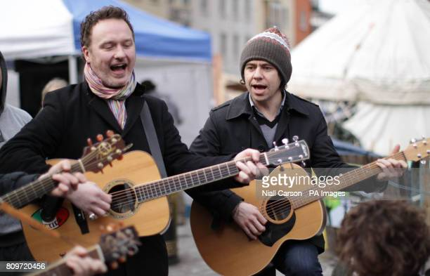 Mundy and Declan O'Rourke busk for Homeless charity the Simon Community during a visit to the Occupy Dame street camp outside the central bank in...
