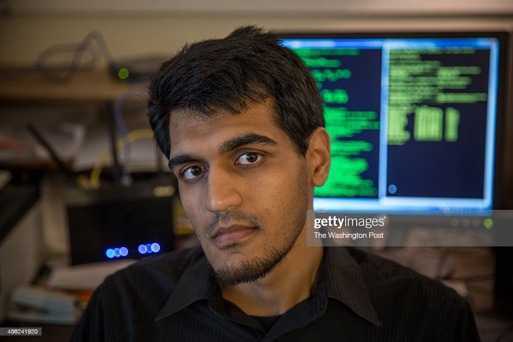 Muneeb Akhter, a young cyber security expert and self-described hacker, poses for a portrait at his home in Springfield, VA, July 30, 2014. Akhter has run afoul of the Department of Homeland Security. He has created a hack that allows him to add money to gift cards from major retailers without spending a dime and now he is under investigation. He said he was approached by DHS agents and asked to join as a hacker.