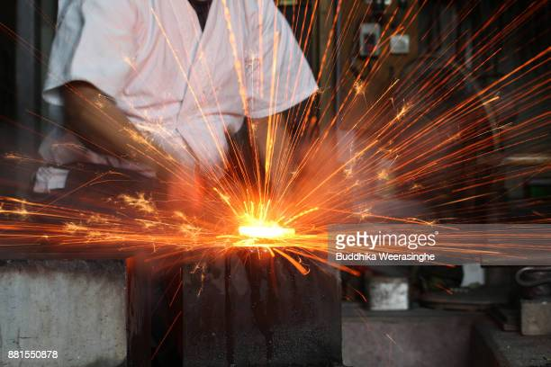 Munehiro Myochin hammers quality Japanese steel as he makes a traditional Japanese sword at his workshop on November 28 2017 in Himeji Japan The...