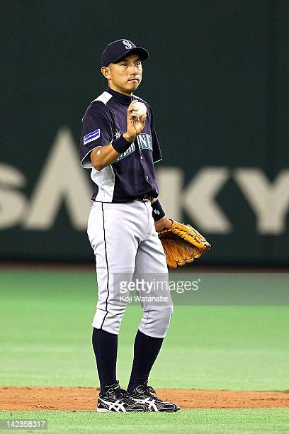 Munenori Kawasaki of Seattle Mariners looks on during the pre season game between Seattle Mariners and Hanshin Tigers at Tokyo Dome on March 25 2012...