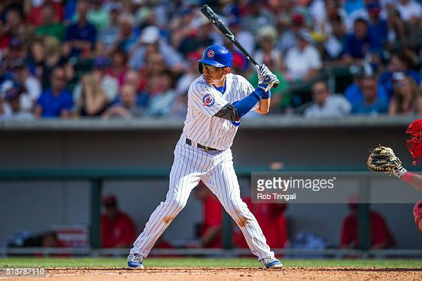 Munenori Kawasaki of the Chicago Cubs bats during a spring training game against the Los Angeles Angels at Sloan Park on March 4 2016 in Mesa Arizona