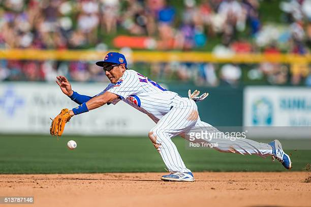 Munenori Kawasaki of the Chicago Cubs defends his position during a spring training game against the Los Angeles Angels at Sloan Park on March 4 2016...