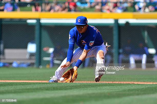 Munenori Kawasaki of the Chicago Cubs fields a ground ball during the spring training game against the Milwaukee Brewers at Sloan Park on March 25...