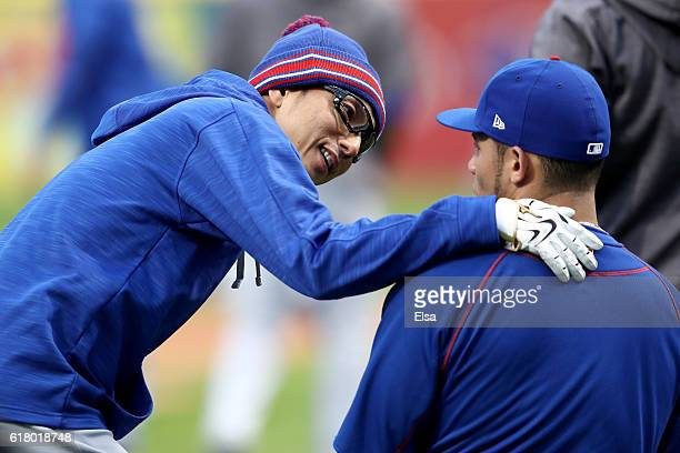 Munenori Kawasaki of the Chicago Cubs jokes around prior to Game One of the 2016 World Series against the Cleveland Indians at Progressive Field on...