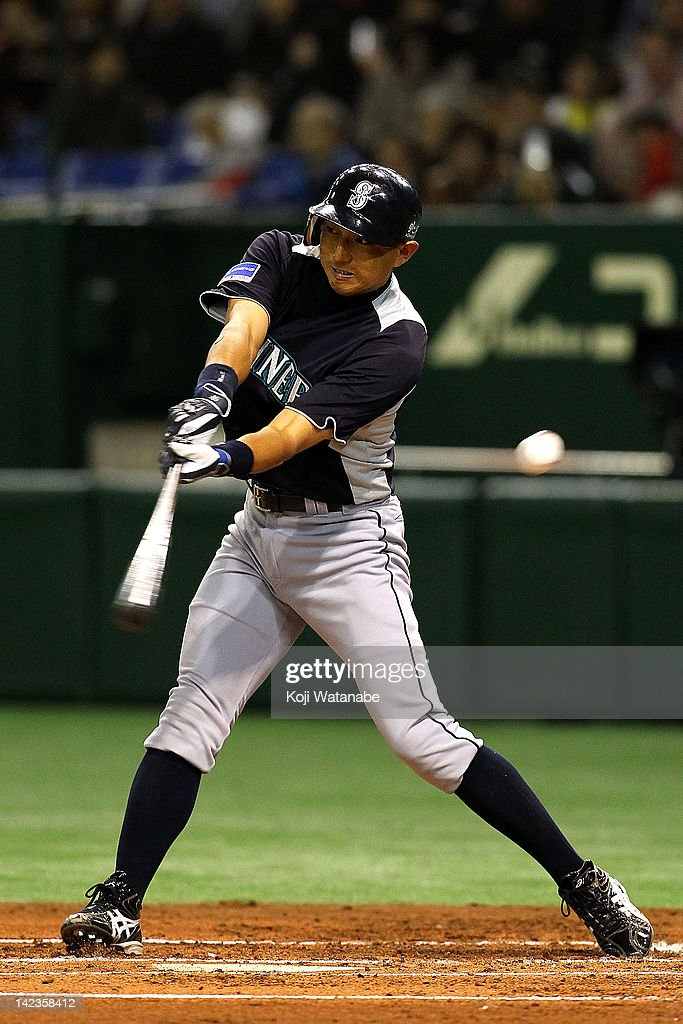 <a gi-track='captionPersonalityLinkClicked' href=/galleries/search?phrase=Munenori+Kawasaki&family=editorial&specificpeople=690355 ng-click='$event.stopPropagation()'>Munenori Kawasaki</a> of the Seattle Mariners at bat during the pre season game between Seattle Mariners and Yomiuri Giants at Tokyo Dome on March 26, 2012 in Tokyo, Japan.