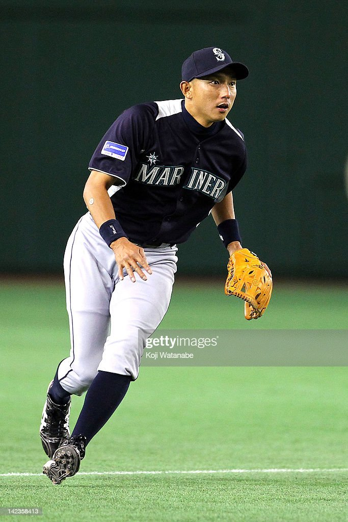 <a gi-track='captionPersonalityLinkClicked' href=/galleries/search?phrase=Munenori+Kawasaki&family=editorial&specificpeople=690355 ng-click='$event.stopPropagation()'>Munenori Kawasaki</a> of the Seattle Mariners fields during the pre season game between Seattle Mariners and Yomiuri Giants at Tokyo Dome on March 26, 2012 in Tokyo, Japan.