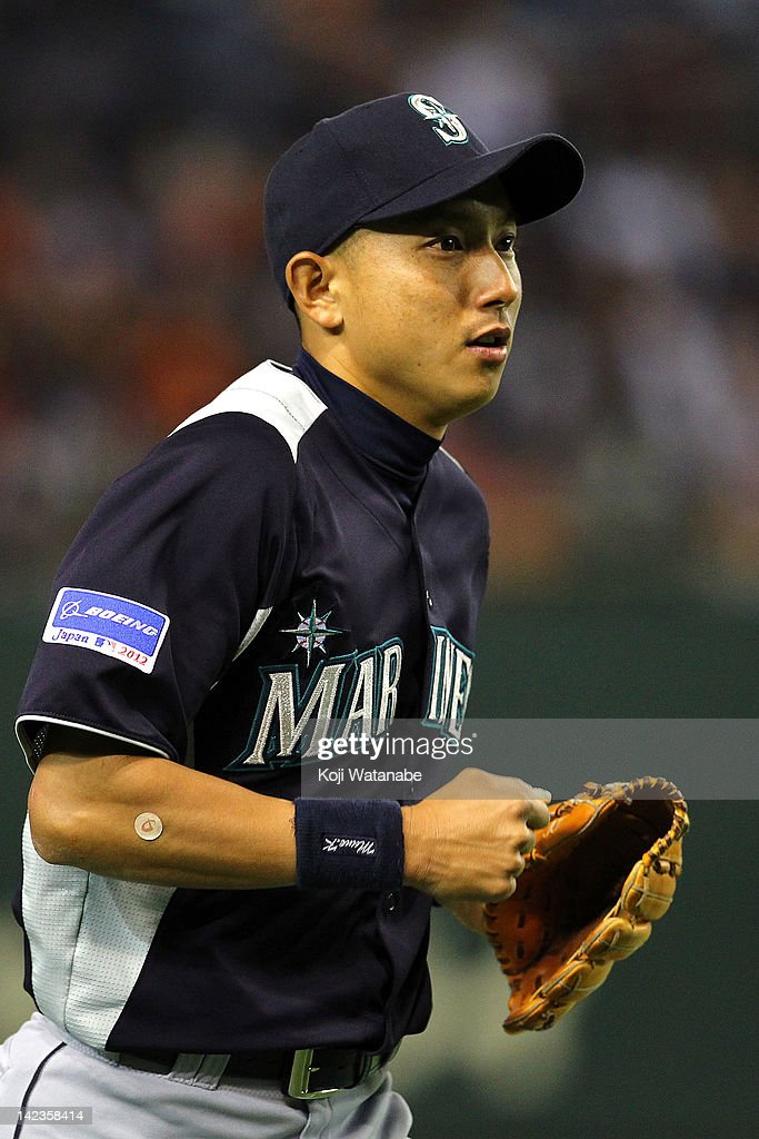 Munenori Kawasaki of the Seattle Mariners fields during the pre season game between Seattle Mariners and Yomiuri Giants at Tokyo Dome on March 26, 2012 in Tokyo, Japan.
