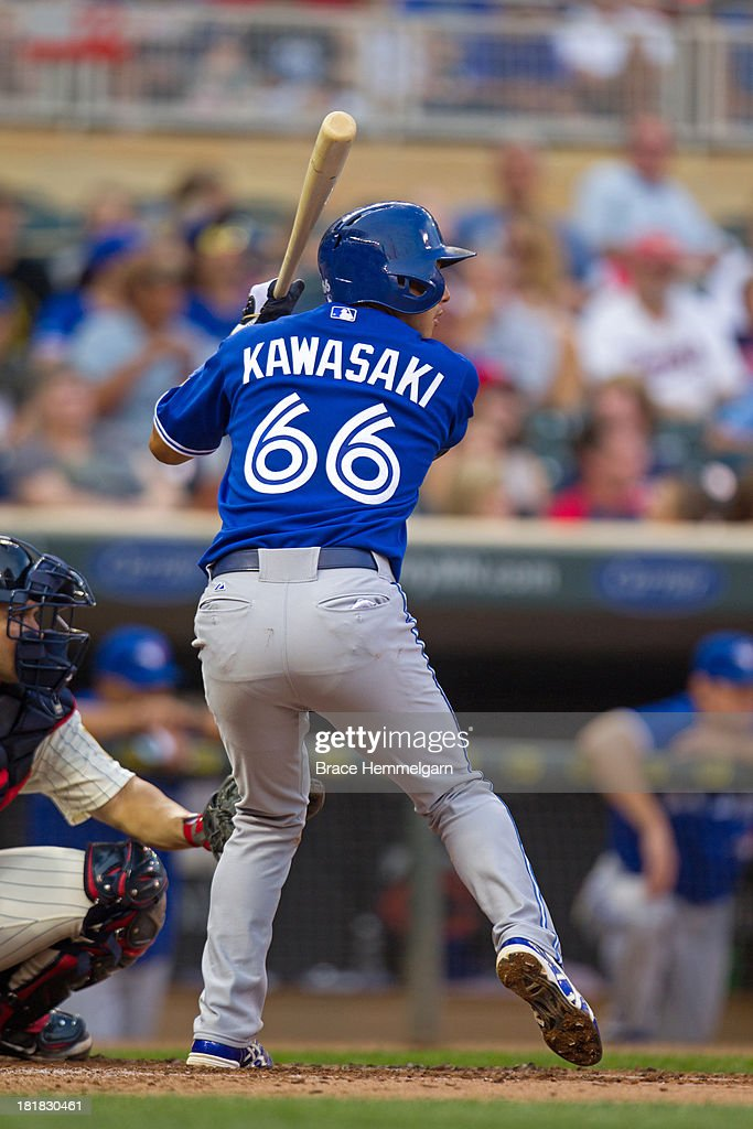 <a gi-track='captionPersonalityLinkClicked' href=/galleries/search?phrase=Munenori+Kawasaki&family=editorial&specificpeople=690355 ng-click='$event.stopPropagation()'>Munenori Kawasaki</a> #66 of the Toronto Blue Jays bats against the Minnesota Twins on August 7, 2013 at Target Field in Minneapolis, Minnesota. The Blue Jays defeated the Twins 11-2.