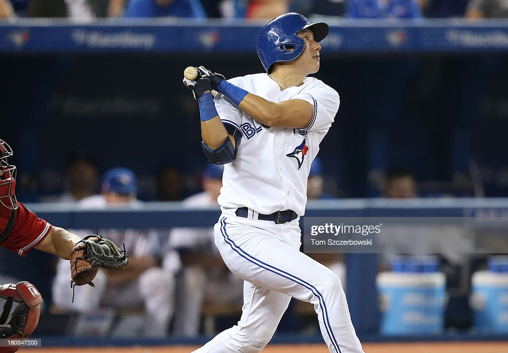 <a gi-track='captionPersonalityLinkClicked' href=/galleries/search?phrase=Munenori+Kawasaki&family=editorial&specificpeople=690355 ng-click='$event.stopPropagation()'>Munenori Kawasaki</a> #66 of the Toronto Blue Jays bats during his pinch at bat in the ninth inning during MLB game action against the Los Angeles Angels of Anaheim on September 11, 2013 at Rogers Centre in Toronto, Ontario, Canada.