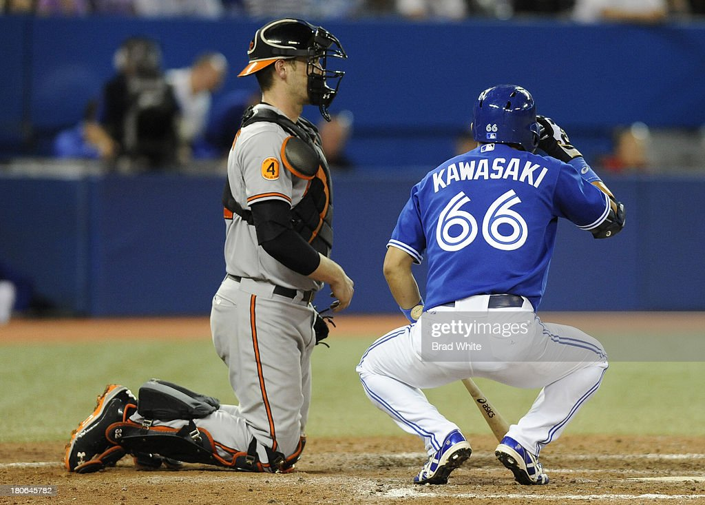 <a gi-track='captionPersonalityLinkClicked' href=/galleries/search?phrase=Munenori+Kawasaki&family=editorial&specificpeople=690355 ng-click='$event.stopPropagation()'>Munenori Kawasaki</a> #66 of the Toronto Blue Jays bats in the eighth inning as Catcher <a gi-track='captionPersonalityLinkClicked' href=/galleries/search?phrase=Matt+Wieters&family=editorial&specificpeople=4498276 ng-click='$event.stopPropagation()'>Matt Wieters</a> #32 of the Baltimore Orioles looks on during MLB game action September 15, 2013 at Rogers Centre in Toronto, Ontario, Canada.