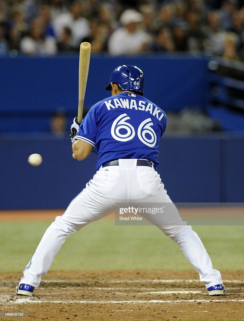 <a gi-track='captionPersonalityLinkClicked' href=/galleries/search?phrase=Munenori+Kawasaki&family=editorial&specificpeople=690355 ng-click='$event.stopPropagation()'>Munenori Kawasaki</a> #66 of the Toronto Blue Jays bats in the eighth inning during MLB game action against the Baltimore Orioles September 15, 2013 at Rogers Centre in Toronto, Ontario, Canada.